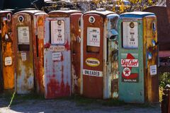 Mid Twentieth Century Gas Pumps. Abandoned and rusting mid Twentieth century gas pumps Stock Images