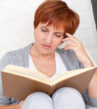 Mid woman reading book Royalty Free Stock Image