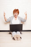 Mid Woman sitting on floor with laptop Stock Photos