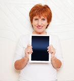 Mid woman with tablet pc Stock Images