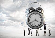 Mida el tiempo del concepto Imagenes de archivo
