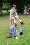 Midage-Akrobaten Stockbilder