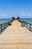 Midday at Naples pier on beach Golf of Mexico Royalty Free Stock Images