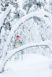 Midddle-aged woman snowshoeing Stock Image