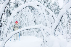 Midddle-aged woman snowshoeing Stock Photos