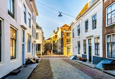 Sunset over Narrow Streets in the Historic City of Middelburg stock photography