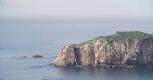 Middelgrote mening van een eiland met het overzees in rust stock footage