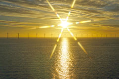Middelgrunden: an offshore wind farm at dawn. Sunrise over the Sea Royalty Free Stock Photo