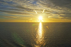 Middelgrunden: an offshore wind farm at dawn. Sunrise over the Sea Stock Images