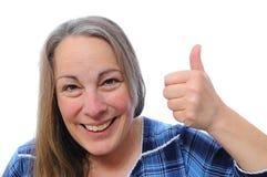 Midden oude vrouw met omhoog duimen Royalty-vrije Stock Foto's