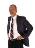 Middenleeftijds het professionele mens bevindende glimlachen Stock Foto's