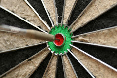 In-the-middle. Cropped shot of front of dart smack in the middle of the bulls eye Royalty Free Stock Photo