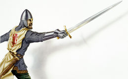 Middle age Ancient warrior with a sword, in action. On white bac Stock Photography