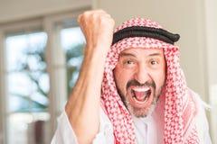 Handsome arabian senior man at home stock photo