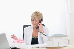 Middle age architect woman having phone call royalty free stock photos
