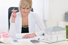 Middle age architect woman working on plans Royalty Free Stock Photo