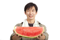 Middle age asian farmer holding Watermelon. Isolated on white Stock Photography
