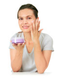 Middle Age Asian Woman apllies cream on her face. Royalty Free Stock Photography