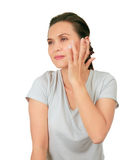 Middle Age Asian Woman apllies cream on her face. Royalty Free Stock Photos