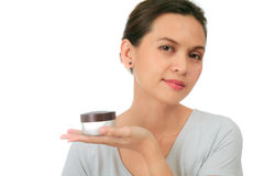 Middle age asian woman with cosmetic cream Royalty Free Stock Photography