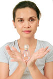 Middle age asian woman with a fragrance bottle Royalty Free Stock Photography