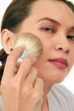Middle age asian woman with make up brush. Royalty Free Stock Photos