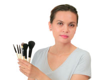 Middle age asian woman with make up brush. Stock Photo