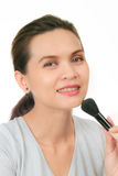 Middle age asian woman with make up brush. Stock Images