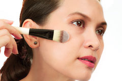 Middle age asian woman with make up brush. Stock Photos
