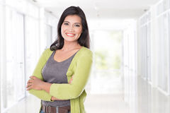 Middle age Asian woman smiling. A portrait of middle age Asian woman smiling to the camera, looking happy royalty free stock photo