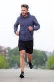 Middle age athlete running outside Stock Images