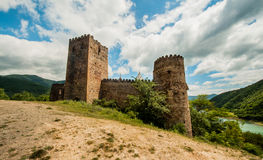 Middle Age, brick castle  in the mountain. Royalty Free Stock Photos