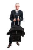 Middle age business man holding up his luggage Stock Photos