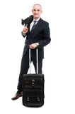 Middle age business man posing with carry on luggage Royalty Free Stock Image