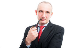 Middle age business man smoking pipe Royalty Free Stock Image