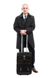 Middle age business man standing with carry on luggage Stock Photos