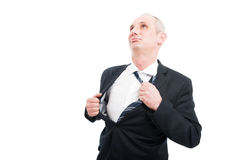 Middle age business man taking his tie off Stock Images