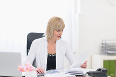 Middle age business woman working with documents Stock Image