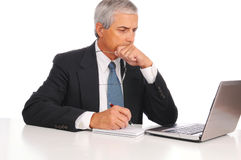 Middle Age Businessman at desk with Laptop Stock Photos