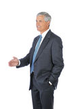 Middle age Businessman with hand extended to shake Royalty Free Stock Image