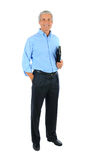Middle age Businessman Hand in Pocket and notebook royalty free stock photo
