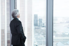 Middle age businessman looking out the window Royalty Free Stock Photo