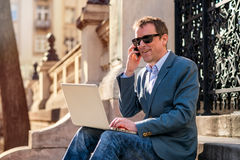 A middle age businessman siting on the stairs Stock Images