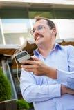 Middle age businessman using smartfone Stock Image