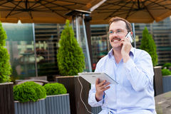 Middle age businessman using smartfone Royalty Free Stock Photo