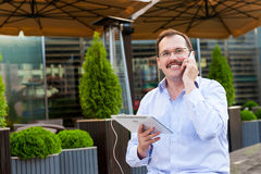 Middle age businessman using smartfone Stock Photo