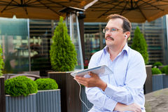 Middle age businessman using tablet Stock Images