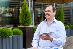 Middle age businessman using tablet Stock Photos