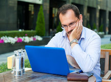 Middle age businessman works on laptop Royalty Free Stock Photography