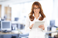 Middle age businesswoman with digital tablet Royalty Free Stock Photography